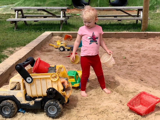 Toddler in the sand pit at Cammas Hall PYO Farm essex