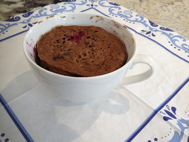 Microwaved blueberry muffin in a  mug