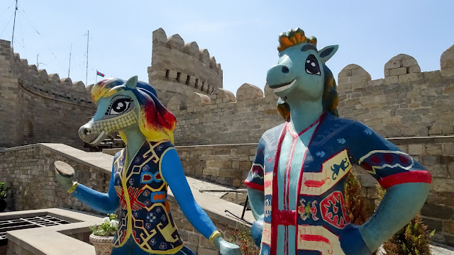 Horse woman and horse man in the old town of Baku