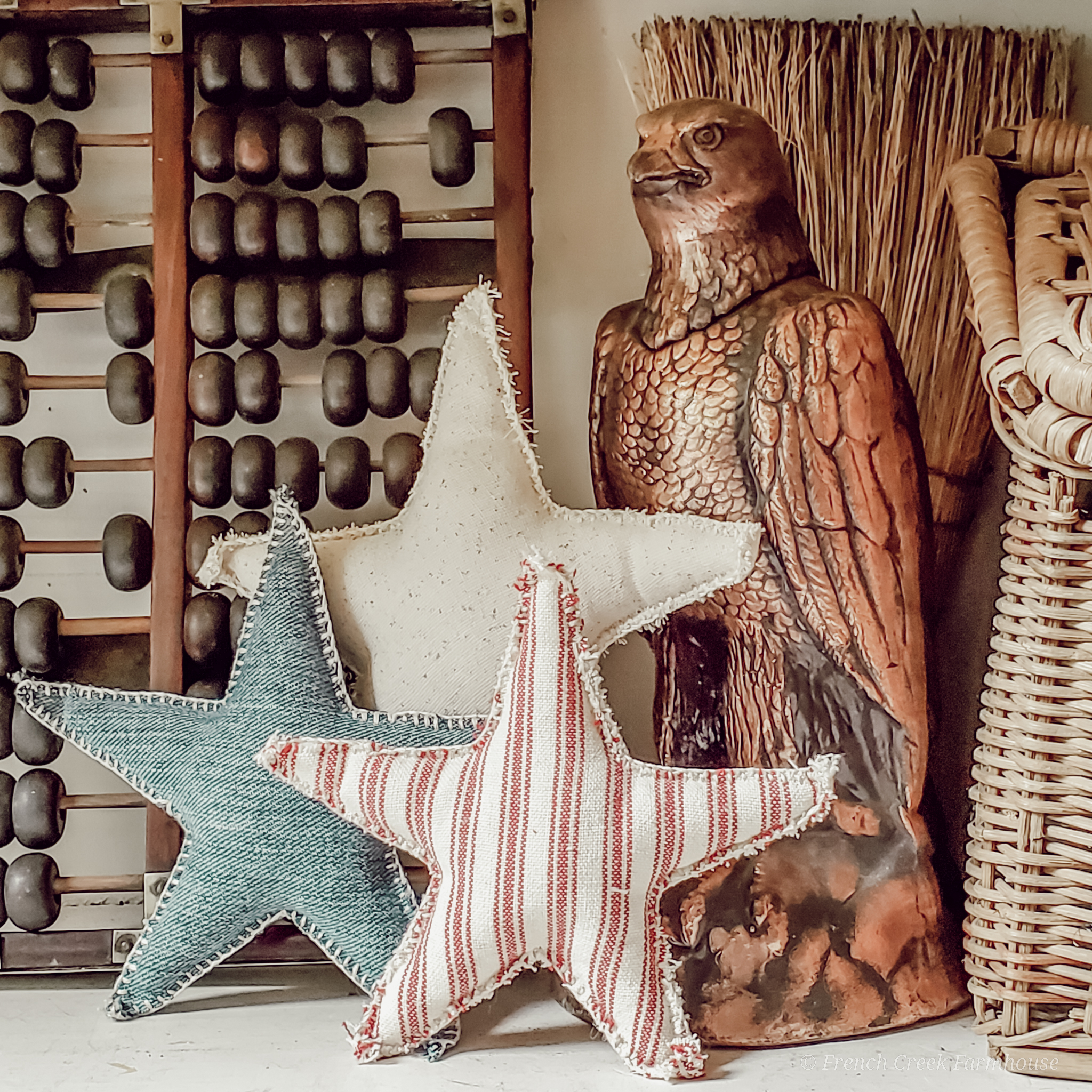 A vintage eagle statue and patriotic stars for Americana charm