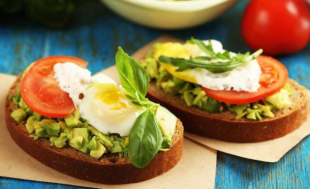 healthy breakfast with avocado, baked avocado fries, skinny fried egg and avocado toast