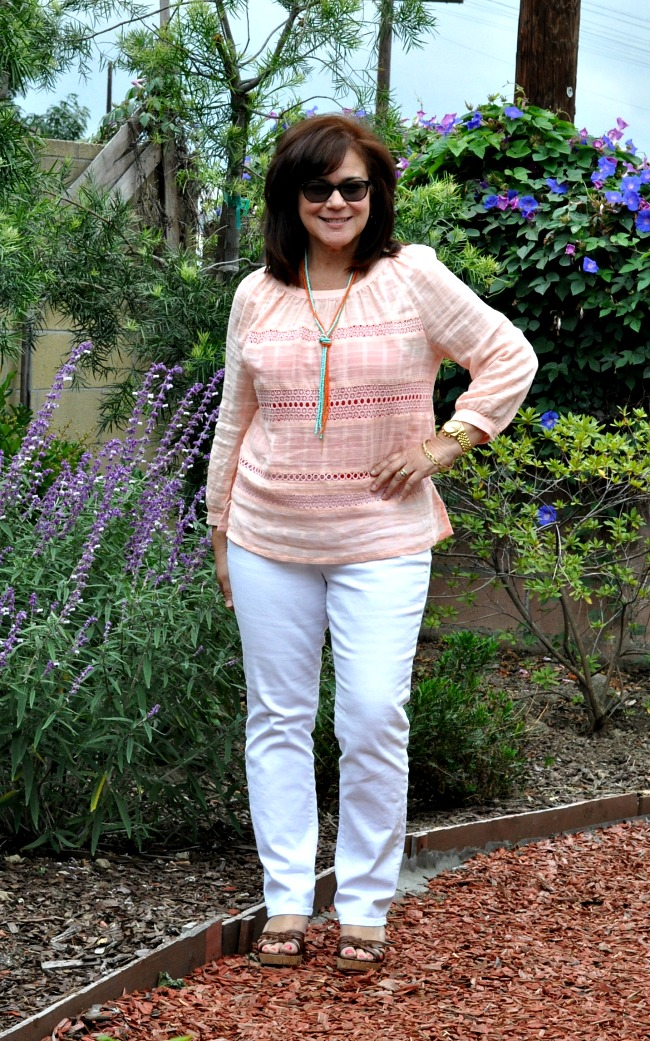 peach blouse and white jeans