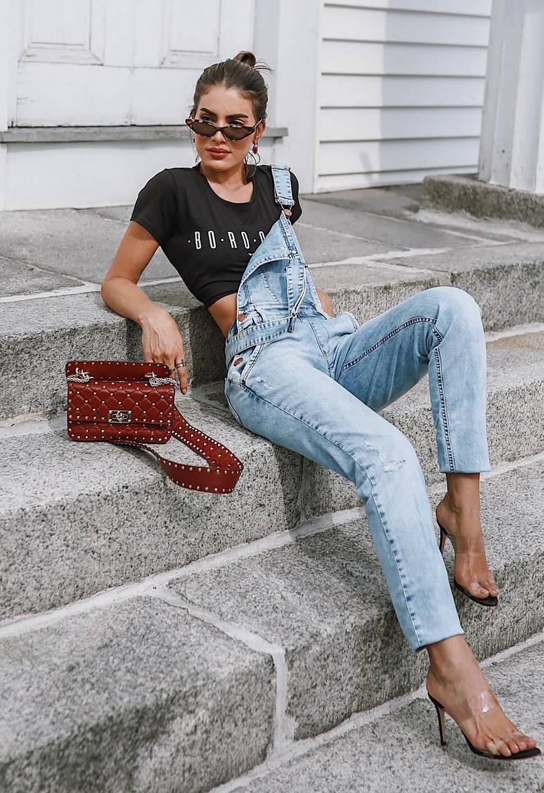 what to wear with a denim jumpsuit : black t-shirt + red bag + heels