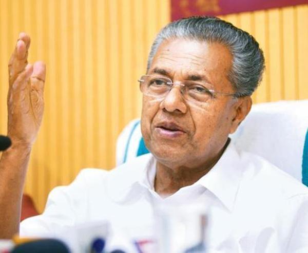 News, Malappuram, Kerala, LDF, Chief Minister, Pinarayi on Cheguera's photo printed flag in govt program