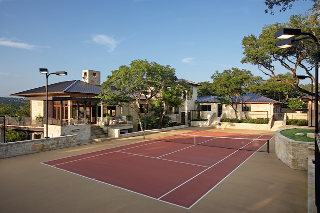 Picture of tennis court in the upper level of property