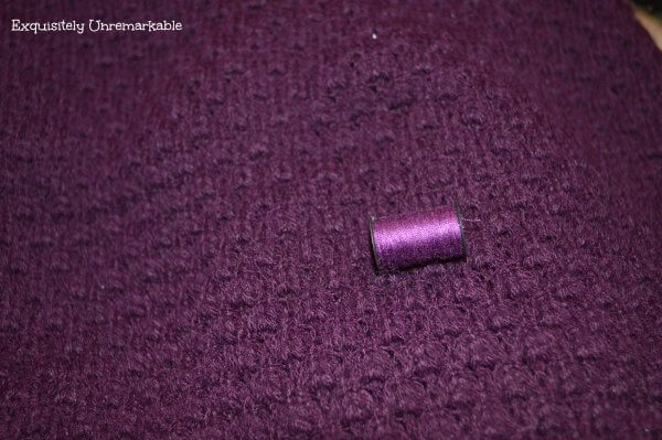 Purple sweater and purple thread to match
