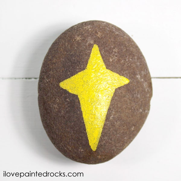 Painting the Star on a rock for the perfect Nativity Set of painted rocks