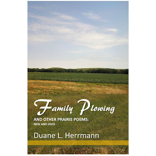 Family Plowing Cover Image of a field and treeline topped by a big blue sky.