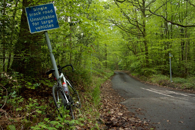 bike leant against single track sign