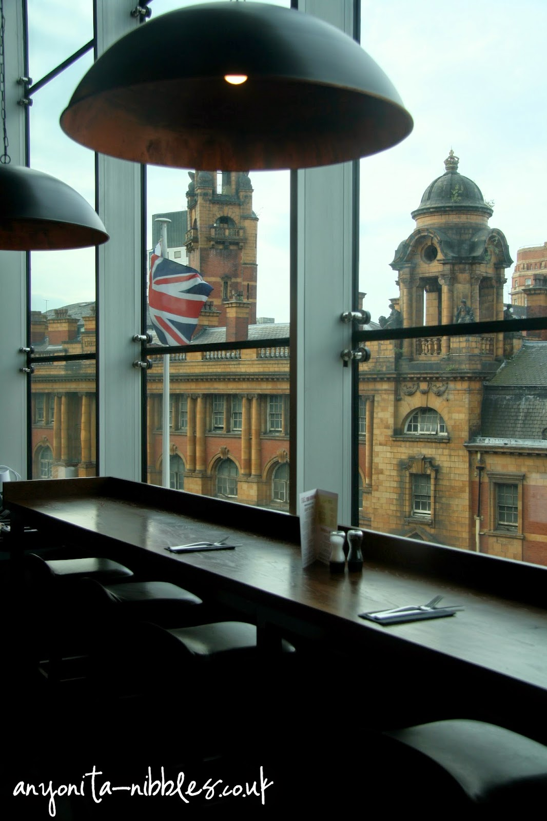 Tables overlooking London street and the abandoned fire station at Manchester Piccadilly | Anyonita-nibbles.co.uk