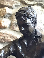 close up of face of boy in sculpture