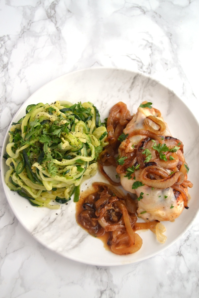 French Onion Chicken and Zoodles takes just 30 minutes to make and features caramelized onions, melted Swiss cheese along with sauteed garlic zucchini noodles. www.nutritionistreviews.com