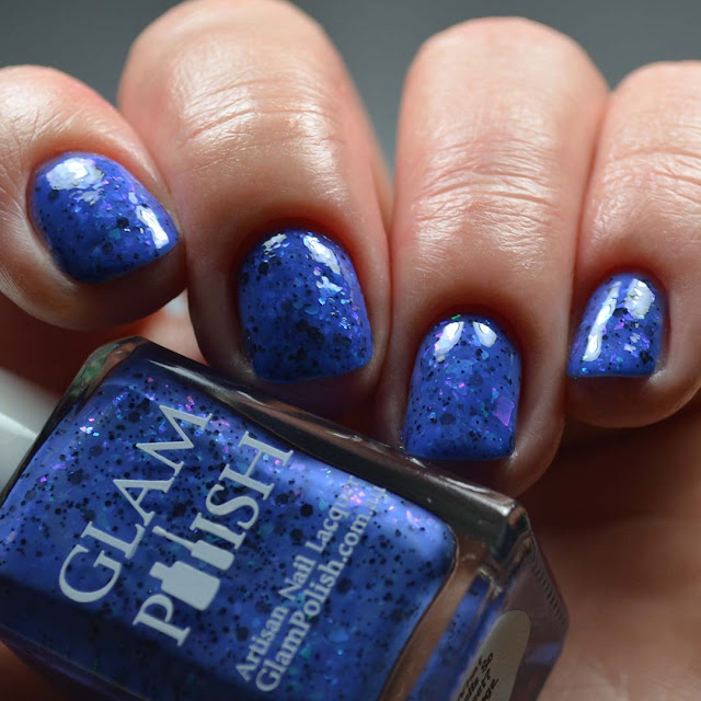 blue nail polish with color shifting flakies low light swatch