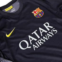 8b6c668621a The Barcelona 13-14 Goalkeeper Home Shirt is black and features the same  fading stripes on the sleeves as seen on the Barcelona 13-14 Home and Away  kits.