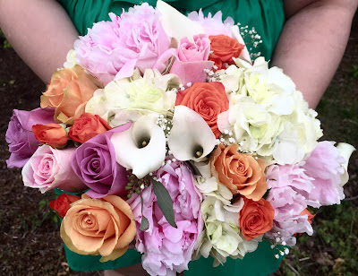Bridal bouquet of roses, peonies, hydrangea and calla lilies by Stein Your Florist Co.