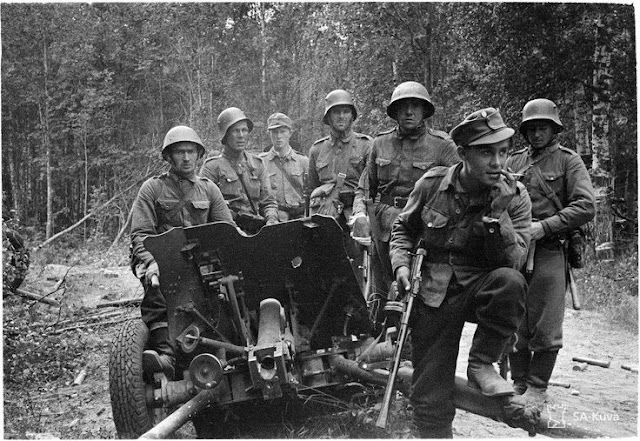 Finnish troops with captured Soviet gun, 31 August 1941 worldwartwo.filminspector.com
