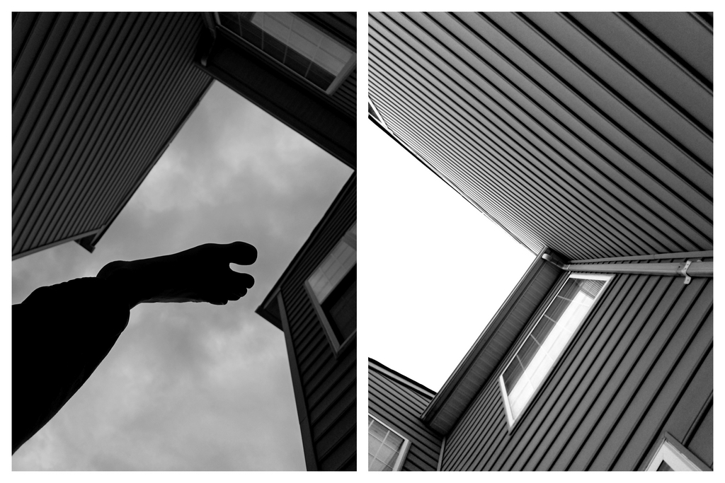 A monochrome frame of a leg and foot's silhouette stepping on the clouds through an alley created by two townhomes juxtaposed alongside a monochrome frame of an alley created by two townhomes paving a path to a bright overexpoxed sky