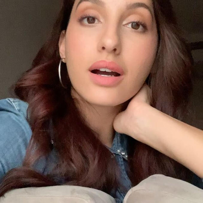 """Canadian dancer and model Nora Fatehi promotes Fitness App. She wrote on Social media, """"Dance with me! I'll be Live on the cure.fit app taking online Dance Fitness classes through Cult Live for you."""