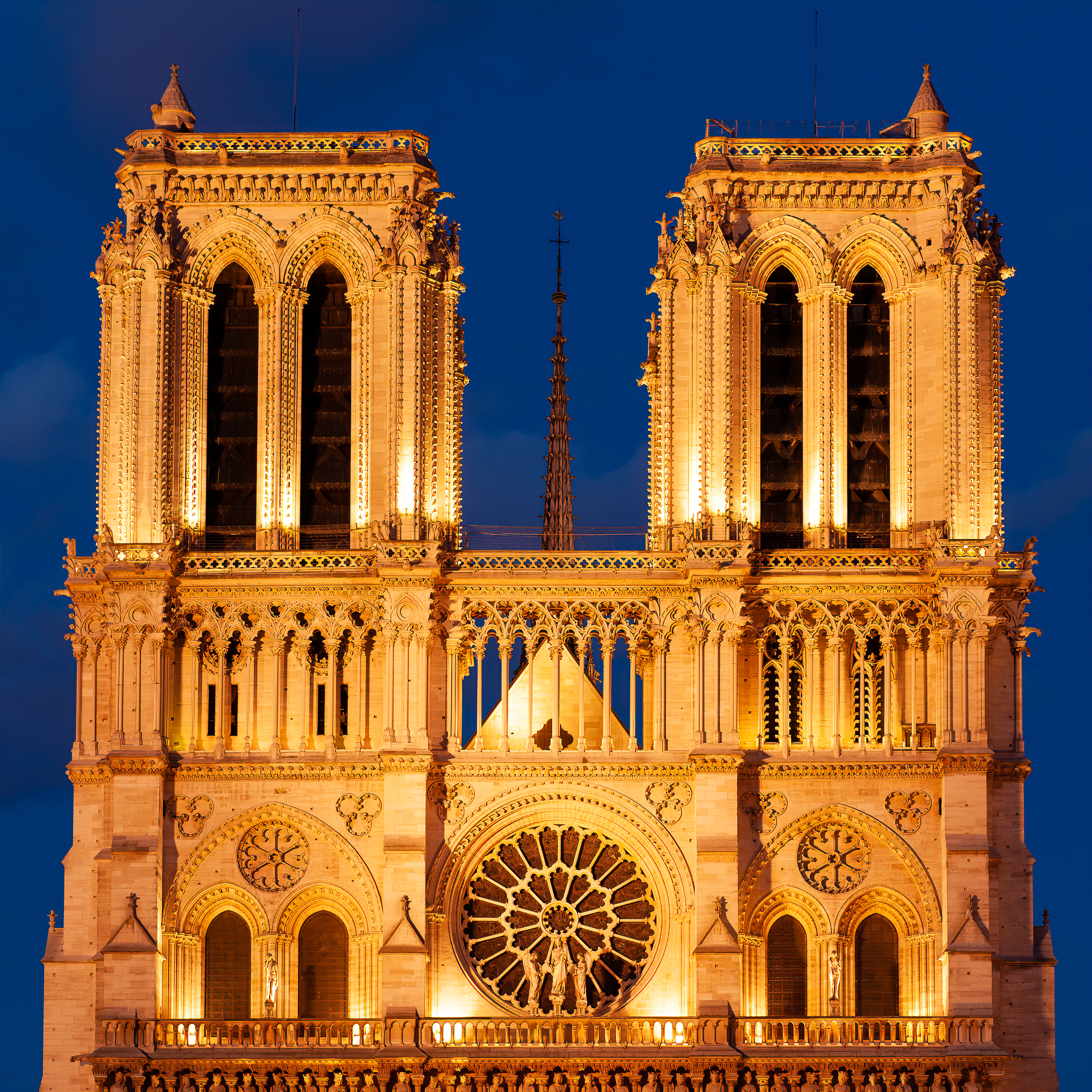 a photo of notre dame cathedral in paris at dusk