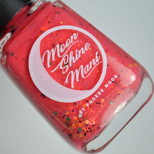 bright coral glitter nail polish in a bottle