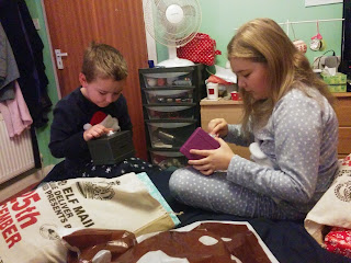 Top Ender and Big Boy opening their gifts. They got Safe Money Boxes from Smiggle.