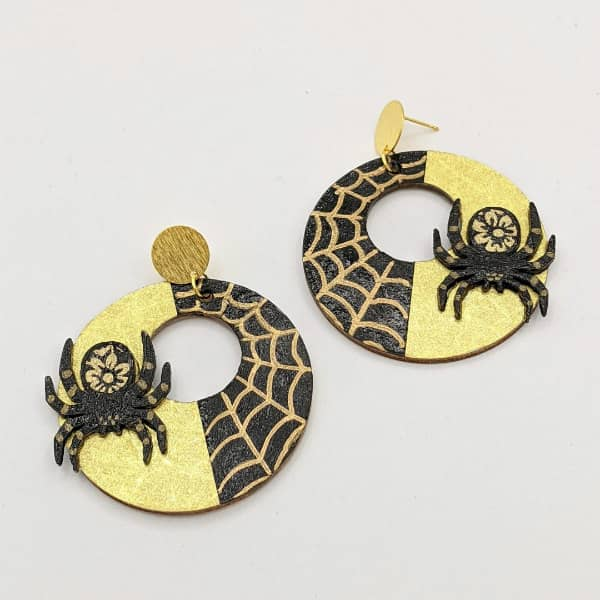 circular earrings composed of origami paper on wood with brass findings and hand painted spiders