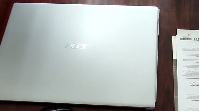 All plastic build of Acer Aspire 3 A315-23 laptop with light silver color.