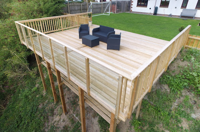 Sloping garden decking wales