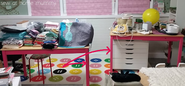 IKEA INGO dining room table hack - sink a sewing machine into the table. She's painted the bases a bright pink with just a Behr sample sized jar, way cheaper than buying a whole quart.