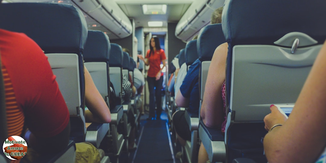 "Featured in the article: ""6 Tips To Get Over Flight Anxiety And Relax On A Plane"". Communicate with Flight Attendants, airplane, passengers, corridor"