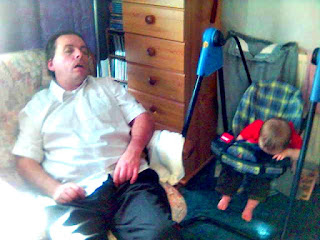 Baby and Dad both Fast Asleep in Separate Chairs