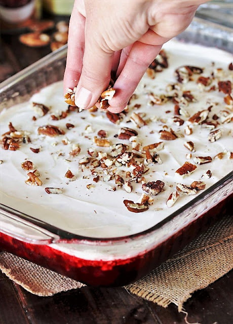 Sprinkling 7-Up Cranberry Jello Salad with Pecans Image