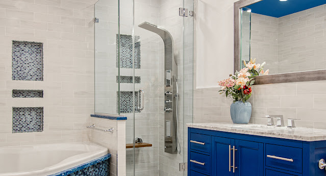 Spa shower in a white and blue bathroom.