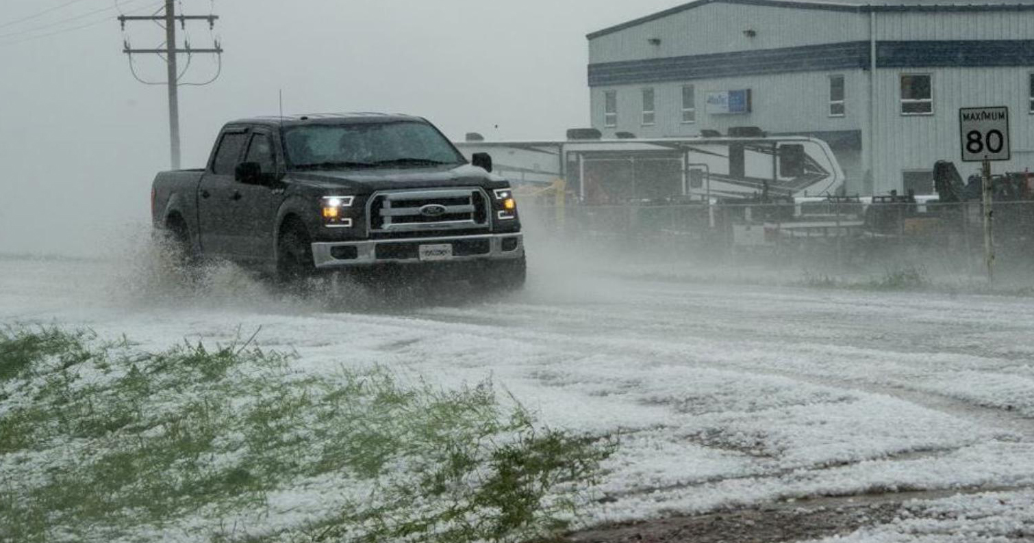 Severe thunderstorms produced large hail that covered