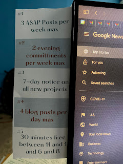 Image of five scheduling rules taped to the side of a computer monitor