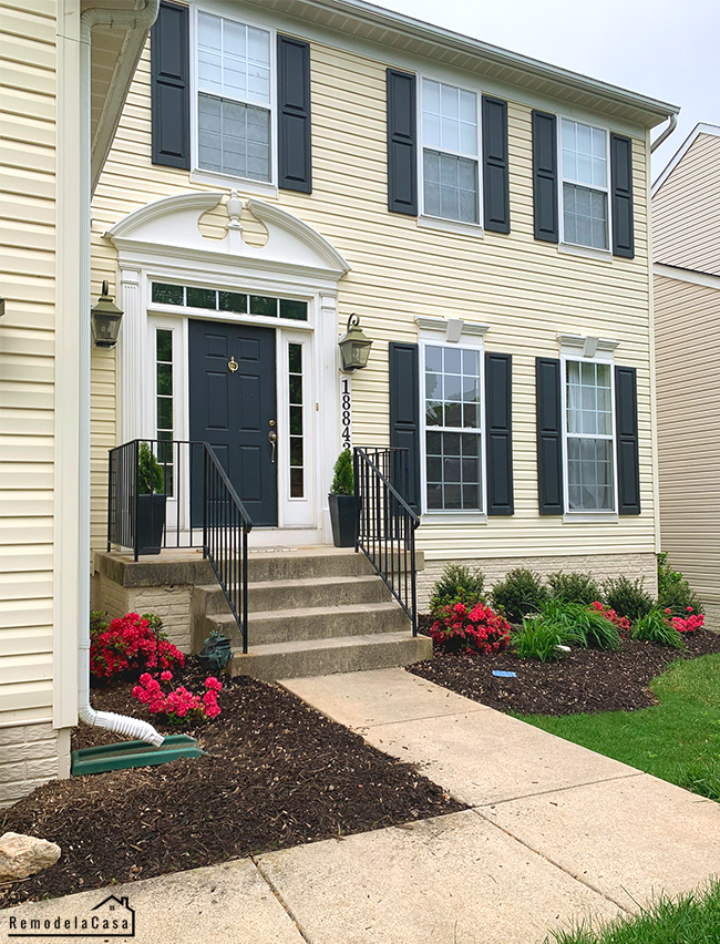 yellow siding house with stoop porch