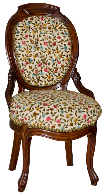 A Victorial walnut chair with round carved back and hand-worked crewel fabric in a floral pattern.