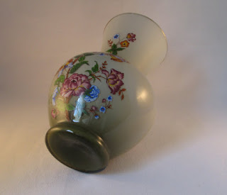 glass vase with butterflies and flowers base view
