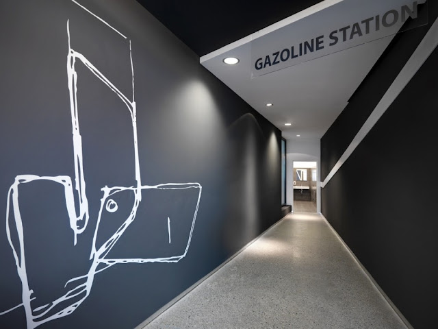 Photo of gray hallway at Gazoline Petrol Station by Damilano Studio Architects