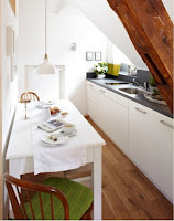 Narrow kitchen ideas with white kitchen table and green cushioned wooden chairs