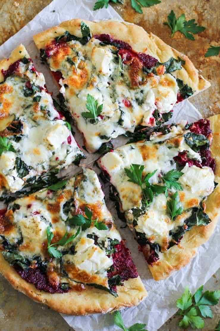 Beet Pesto Pizza with Kale and Goat Cheese | Photo Courtesy of The Roasted Root