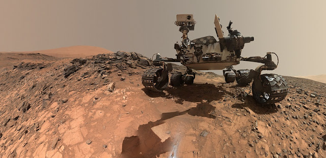 "This low-angle self-portrait of NASA's Curiosity Mars rover shows the vehicle at the site from which it reached down to drill into a rock target called ""Buckskin."" The MAHLI camera on Curiosity's robotic arm took multiple images on Aug. 5, 2015, that were stitched together into this selfie. Credits: NASA/JPL-Caltech/MSSS"