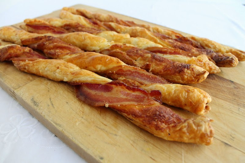 Food Lust People Love: Puff pastry spread with Dijon and sprinkled with Parmesan, then twisted with streaky bacon, is baked till it's crispy, puffed and golden. Bacon Parmesan Twists are a divine savory snack!