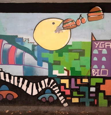 Pac-Man street art by Gorse Hill Studios in Stretford