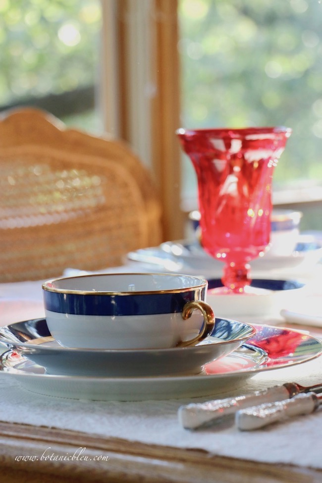 Labor Day patriotic French Country table setting with gold rimmed soup bowls