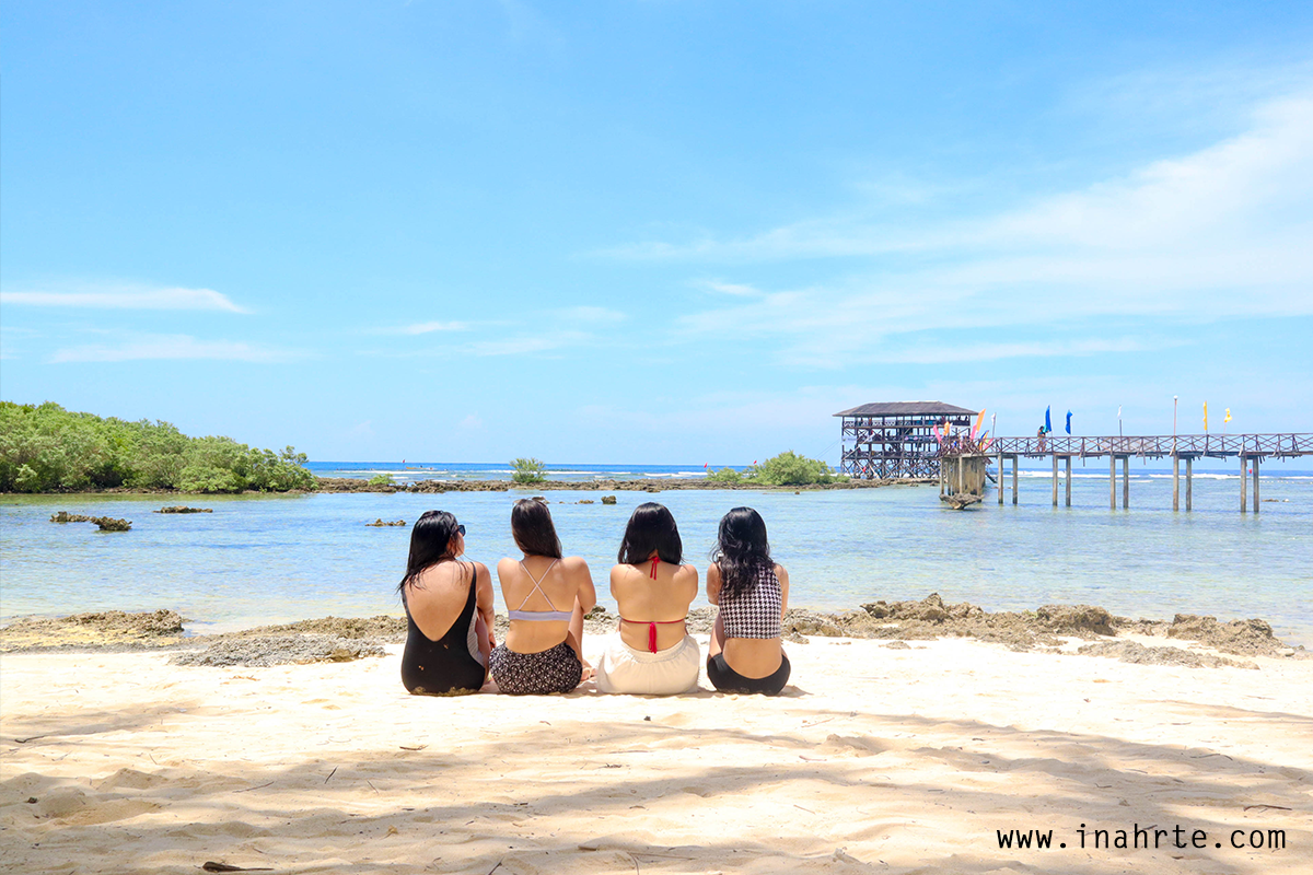 INAHRTE | four girls seating by the beach with beautiful view