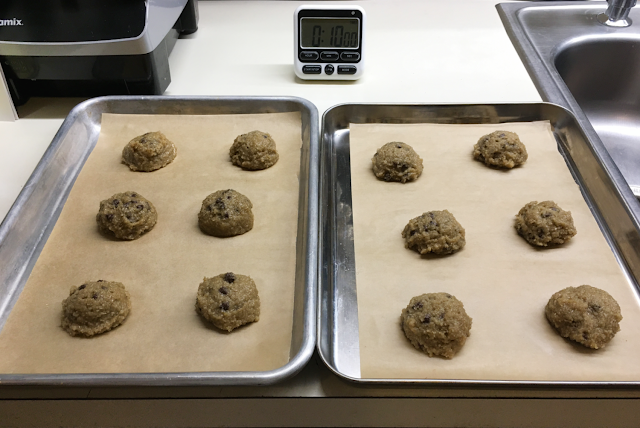 Image of 12 scoops of Good Dee's low carb chocolate chip cookie dough on baking parchment lined cookie sheets