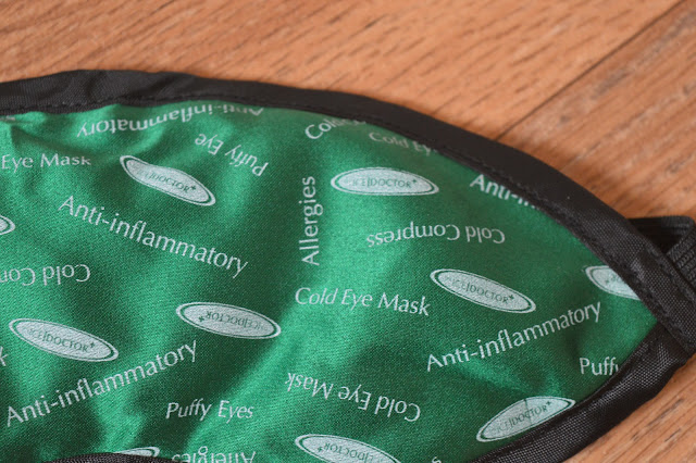 Close up of black, green and white eye mask.