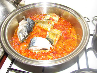 fish cooking in the sauce