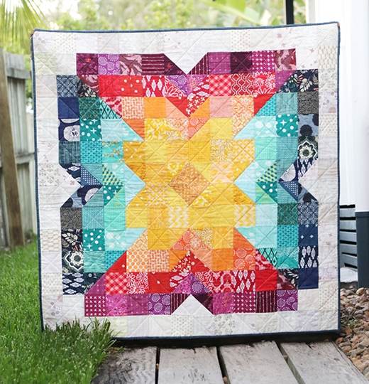 Scrappy Posie Baby Quilt designed by Kirsty of Bonjour Quilts